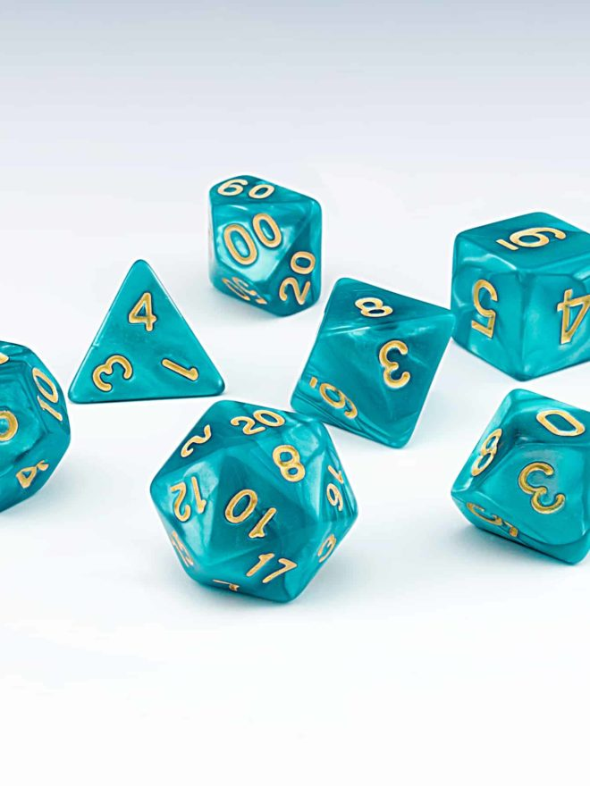 Cascade light blue pearlescent set of 7 RPG dice with Gold numbers from Northumbrian Tin Soldier on a white background