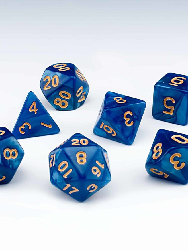 Abyss Dark blue pearlescent set of 7 RPG dice with Gold numbers from Northumbrian Tin Soldier on a white background