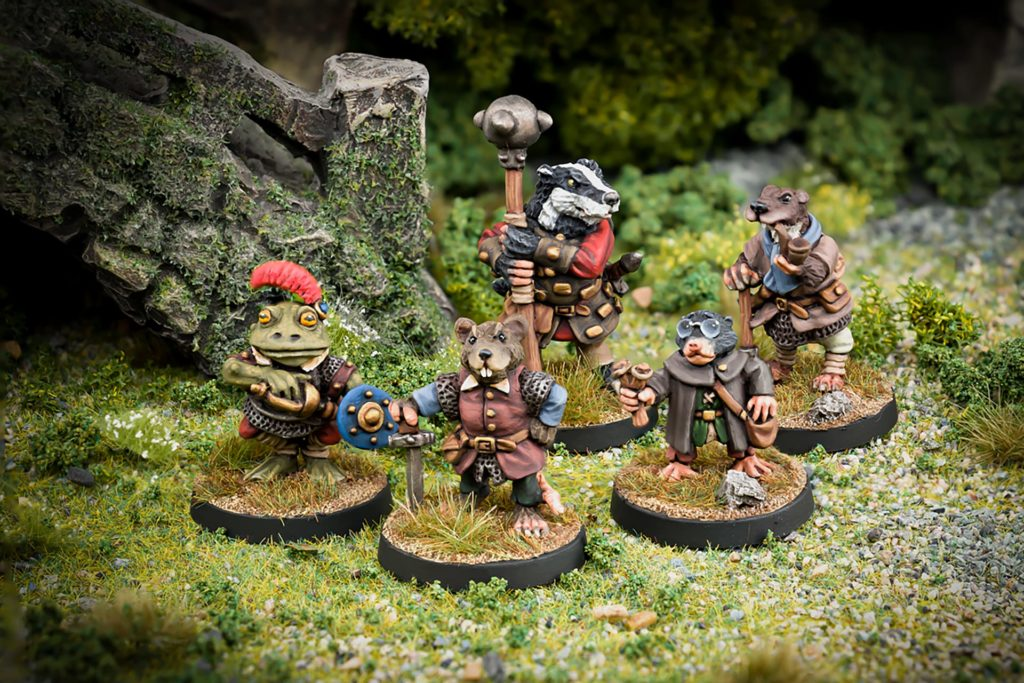Guardians of the riverbank Ratty Toad Badger Mole and Otter 28mm fanstasy miniatures in high quality white metal from Northumbrian Tin Soldier beside the bridge standing on Grass