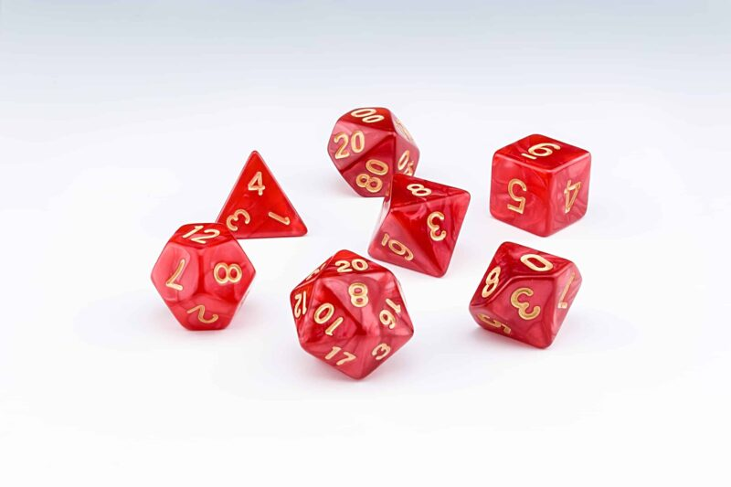 Candescence red pearlescent set of 7 RPG dice with Gold numbers from Northumbrian Tin Soldier on a white background