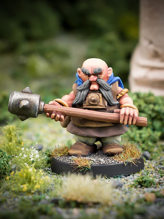 Malfolio Ironbraid male Dwarf with large club 28mm fanstasy miniatures in high quality white metal from Northumbrian Tin Soldier in the Darkewood standing on Grass